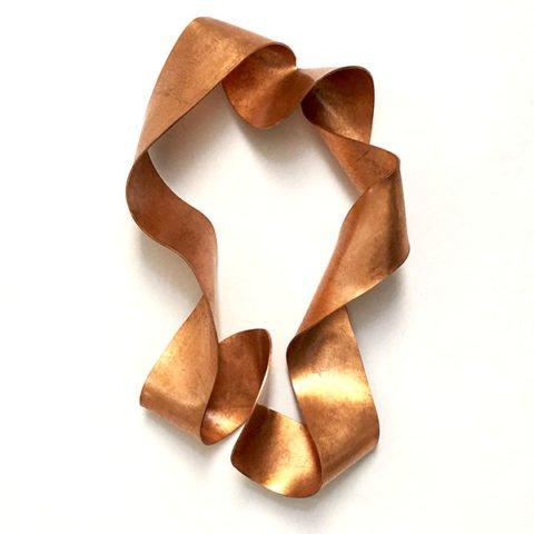 escultura de parede casulo cobre